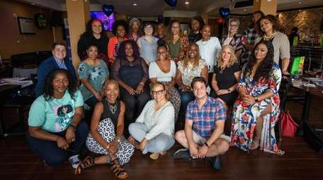 Women's Diversity Network's members pose for a group