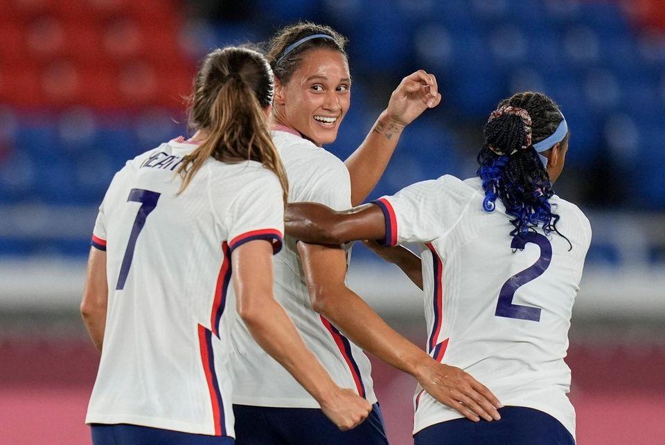 United States' Lynn Williams, center, celebrates with teammates