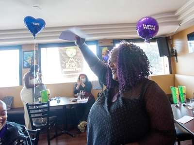 Women's Diversity Network founder Shanequa Levin cheers for
