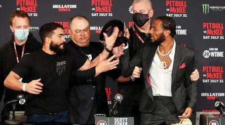 "Patricio ""Pitbull"" Freire, left, and AJ McKee, get"