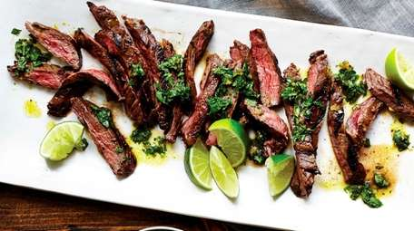 Skirt steak is marinated, cooked and served with