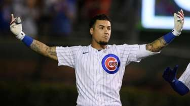 Chicago Cubs' Javier Baez celebrates after hitting a