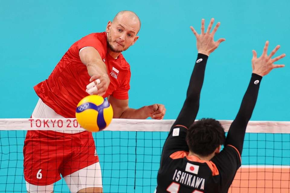 Bartosz Kurek #6 of Team Poland strikes against