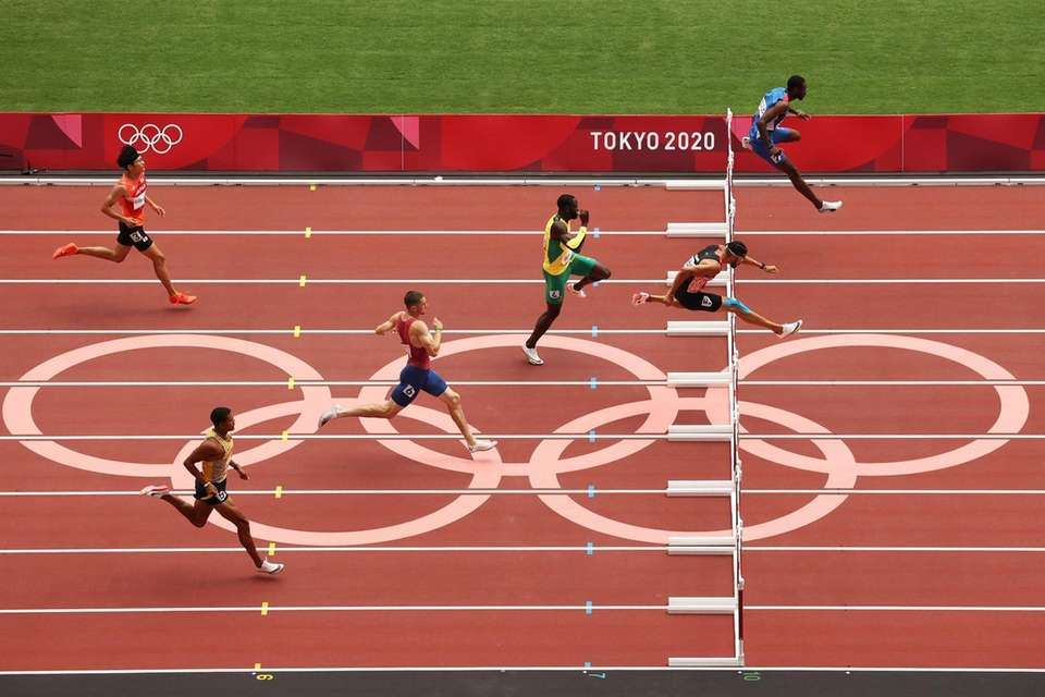 Athletes compete during round one of the Men's