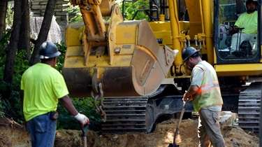 Work underway July 30 on a drainage project