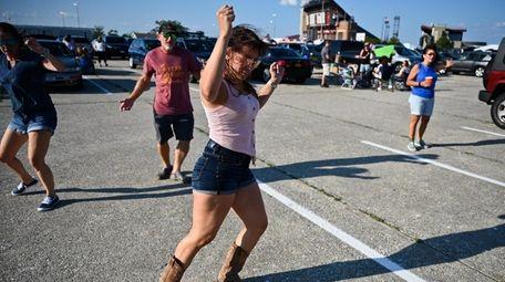 Julianne Bertini, left, of Merrick, line dances with