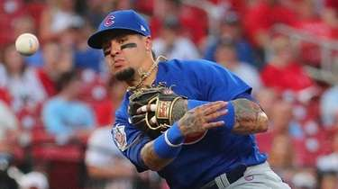 Javier Baez of the Cubs throws to first