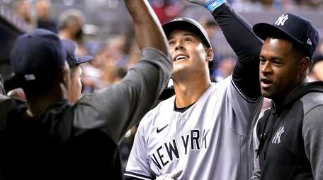 The Yankees' Anthony Rizzo celebrates in the dugout