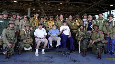 World War II veterans Eugene Leavy, center left,