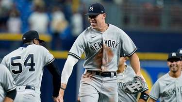 The Yankees' Aaron Judge, center, celebrates with relief