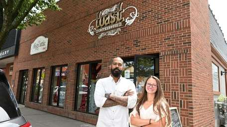 Managers Andre DuChausses and Melissa Reinheimer outside Toast