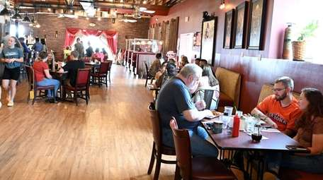 Patrons dine at Toast Coffeehouse in Patchogue on