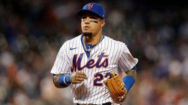 Javier Baez of the Mets runs to the