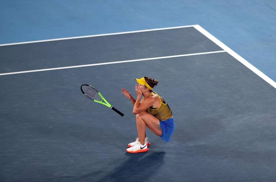 Elina Svitolina of Team Ukraine celebrates victory in