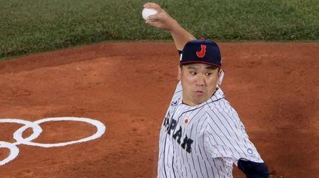 Japan's starting pitcher Masahiro Tanaka hurls the ball
