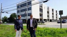 Business partners Paul Posillico, left, and Robert DiNoto