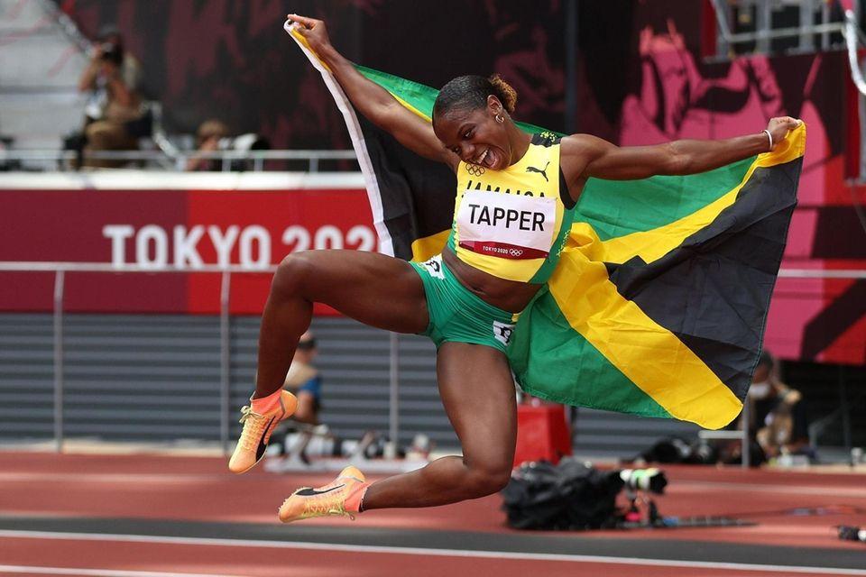 Megan Tapper of Team Jamaica celebrates winning the