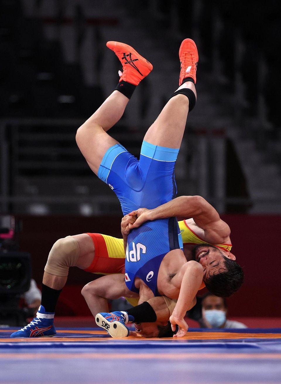 Demeu Zhadrayev of Team Kazakhstan competes against Shohei