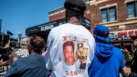 A fan wears a shirt honoring the late