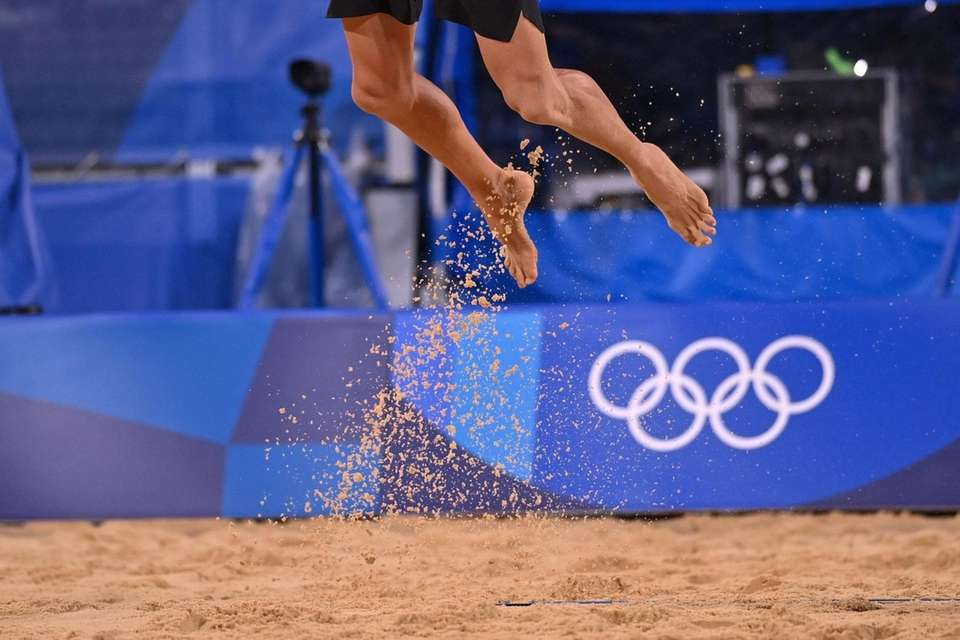 Sand falls to the ground as USA's Jacob