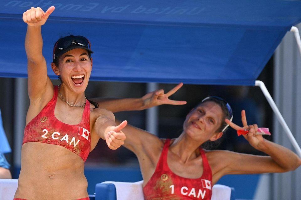 Canada's Melissa Humana-Paredes (L) and Sarah Pavan celebrate