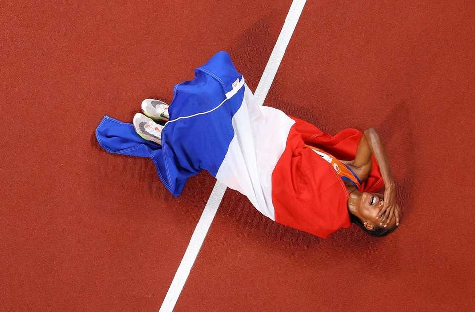 Sifan Hassan of Team Netherlands reacts after winning