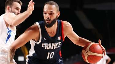 Evan Fournier of Team France drives to the