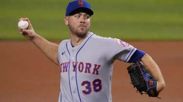 Tylor Megill of the New York Mets delivers