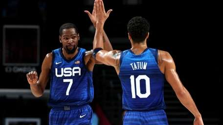 Kevin Durant #7 and Devin Booker #15 of