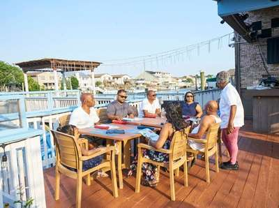 Chef/owner Bibi Bethune chats with patrons, Caribbean Island,