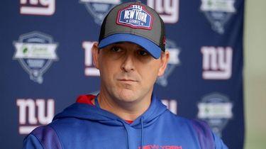 Giants head coach Joe Judge speaks with the