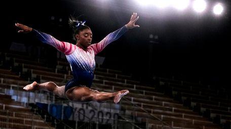 Gymnast Simone Biles returns and quietly wins a