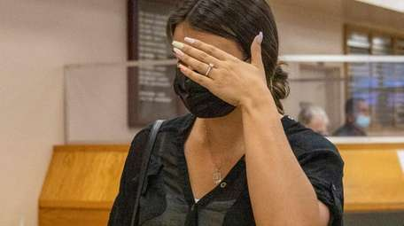 Elena Santana leaves Nassau County District Court in
