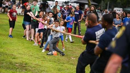 Liam Carrasquilla, 6, of Moriches, leads the pack