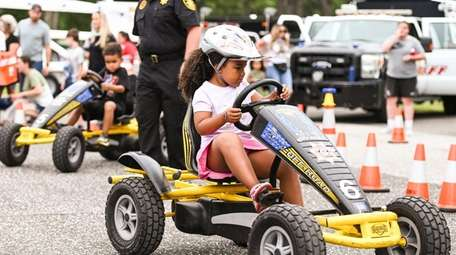 Bella Horne, 5, of Shirley, rides a pedal