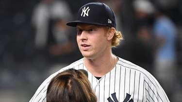 Yankees relief pitcher Stephen Ridings is interviewed after