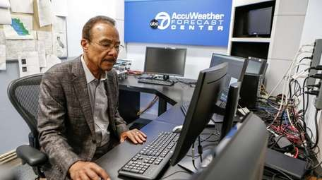 Spencer Christian, 74, works at his weather station
