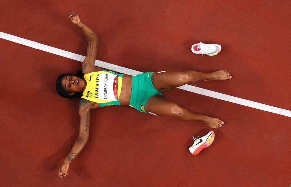 Elaine Thompson-Herah of Team Jamaica reacts after winning
