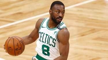 Kemba Walker #8 of the Boston Celtics dribbles