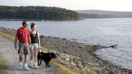 Visitors take in the view at Lake Wallenpaupack