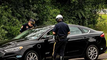Nassau County Highway Patrol officers at work Wednesday