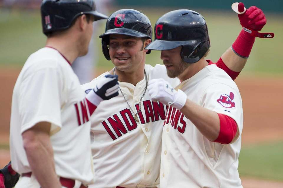 Drew Stubbs #11 and Nick Swisher #33 celebrate