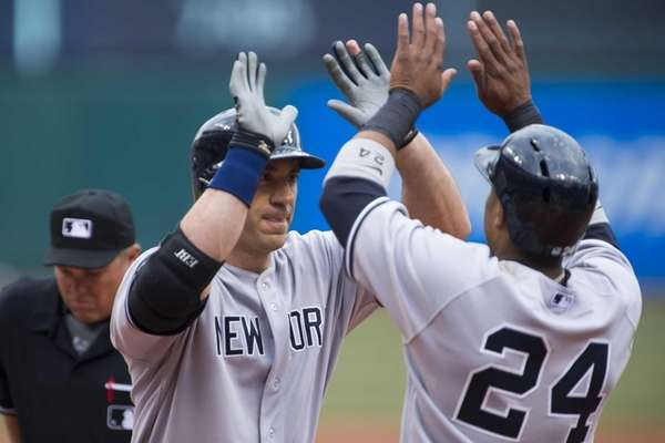 Travis Hafner celebrates with Robinson Cano after Hafner