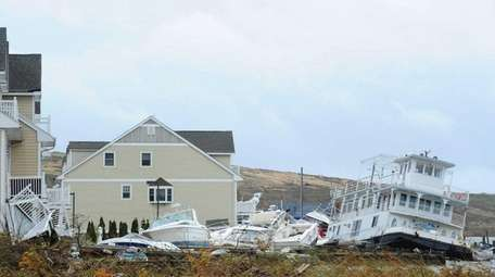 Damaged homes and displaced boats in Island Park