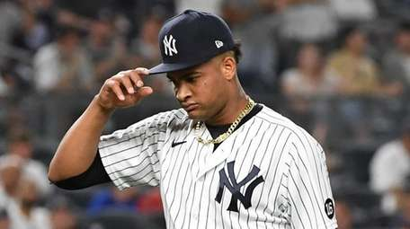 Yankees starting pitcher Luis Gil walks to the