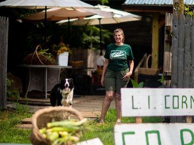 Meghan Bush at her farm stand, Meghan's Munchies.