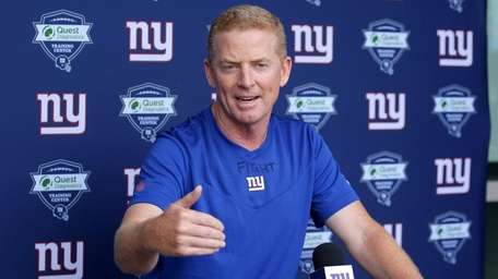 Giants offensive coordinator Jason Garrett speaks to the