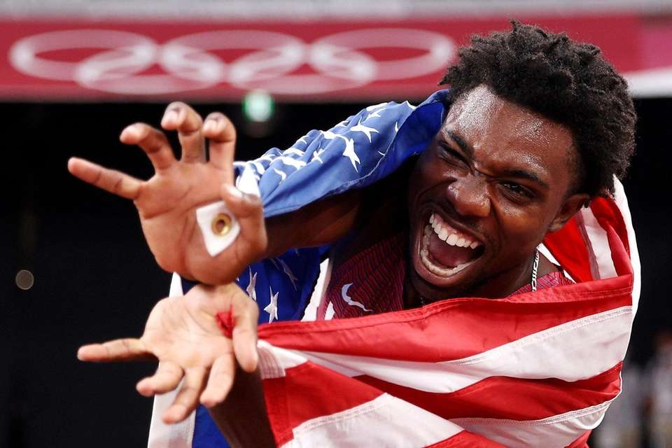 Noah Lyles of Team United States celebrates after
