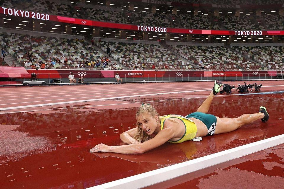Genevieve Gregson of Team Australia lays injured during