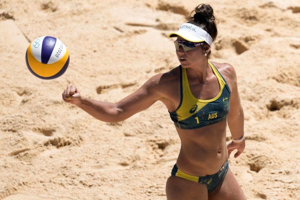Mariafe Artacho del Solar, of Australia, hits the